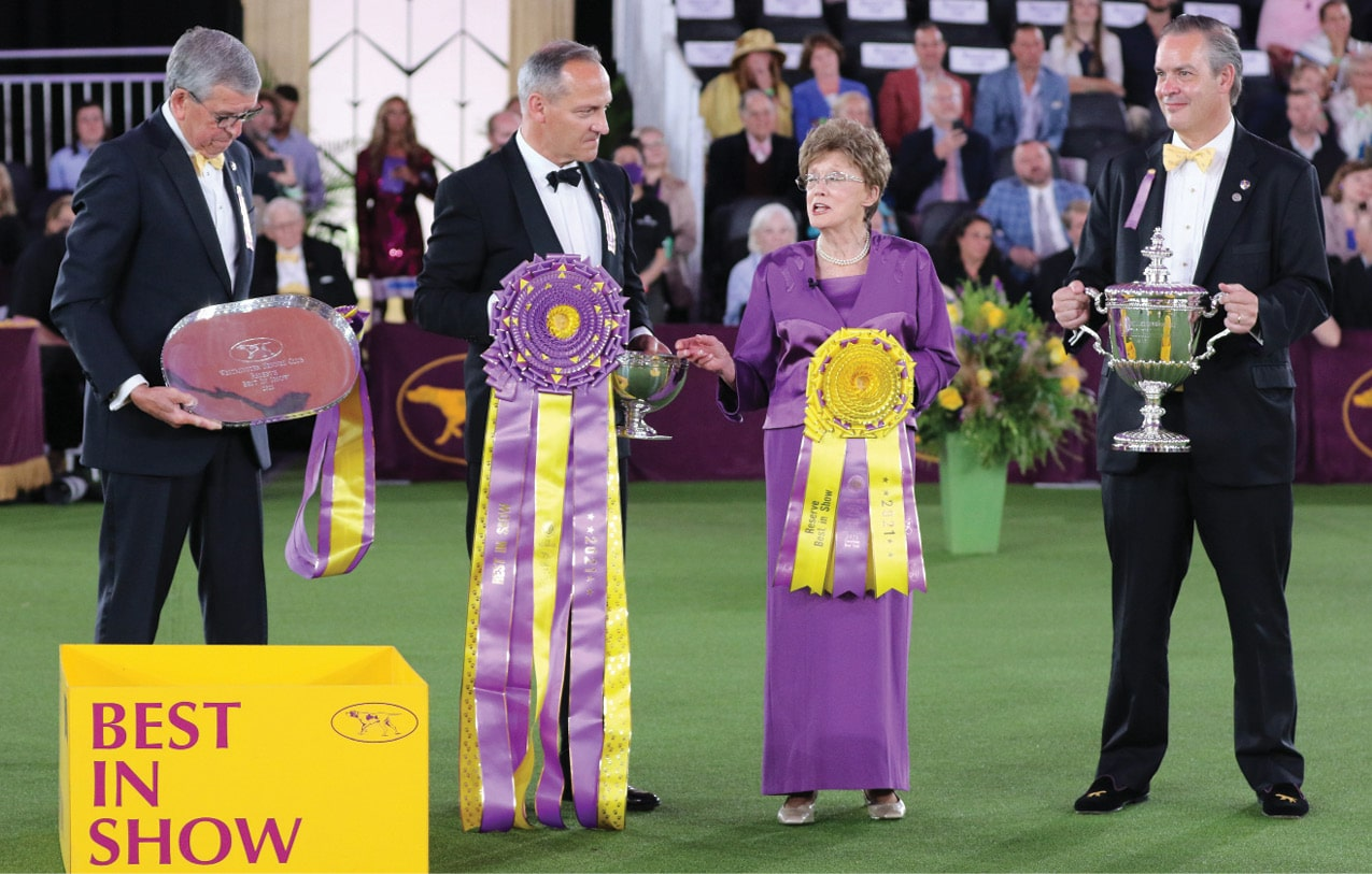 Judge Patricia Craige Trotter speaks to the crowd before awarding Best in Show. L/R David A. Heming, David W. Haddock, and Charlton Reynders, III.